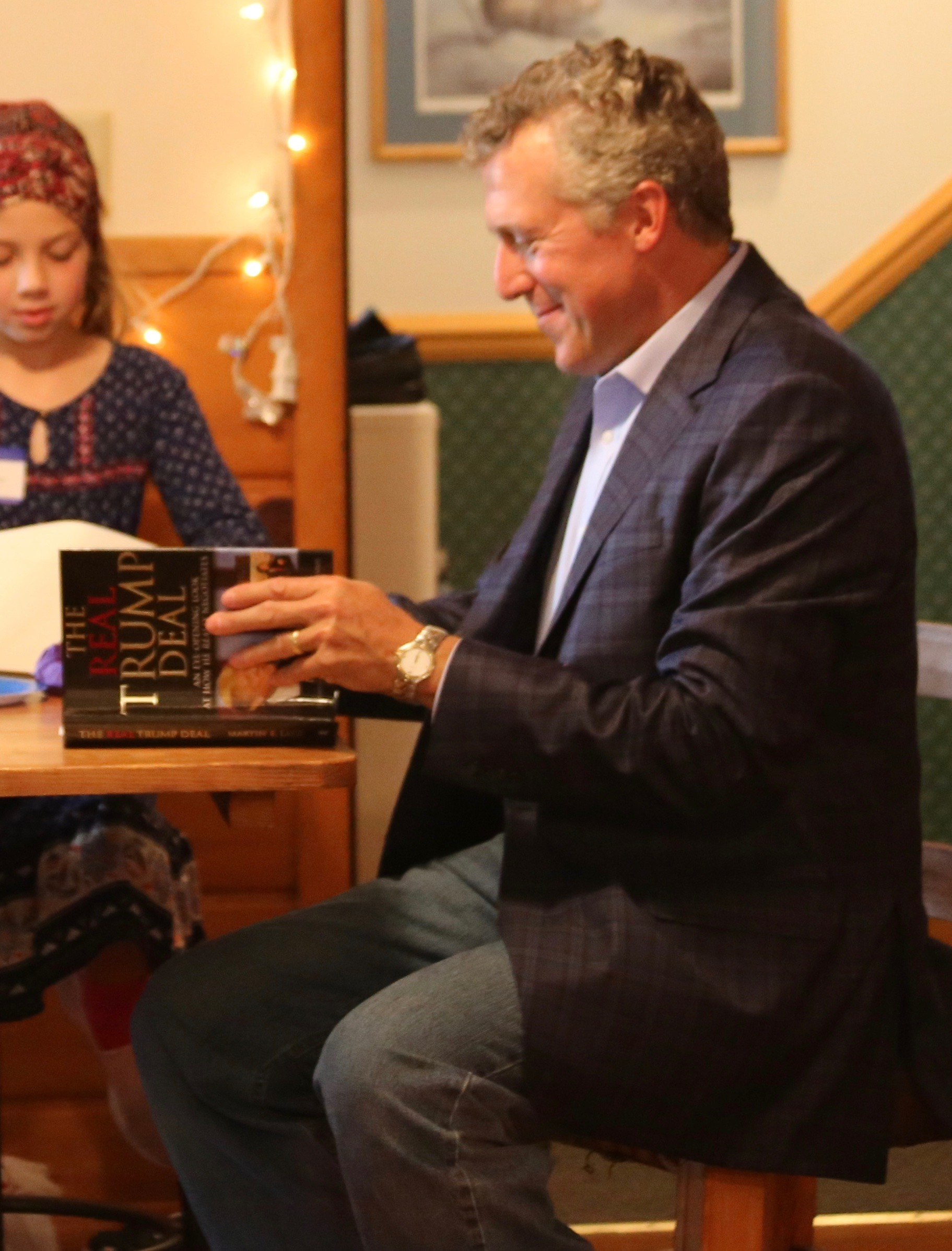 Photo of Negotiation Expert Marty Latz at book signing